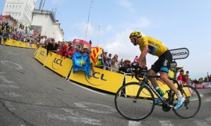 Chris Froome rides to victory on Mont Ventoux. Photograph: Bryn Lennon/Getty Images