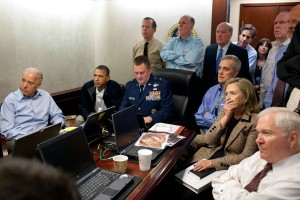 Figure 2, Secretary of State Hillary Clinton, first row, second from right. Pete Souza [Public domain], via Wikimedia Commons.