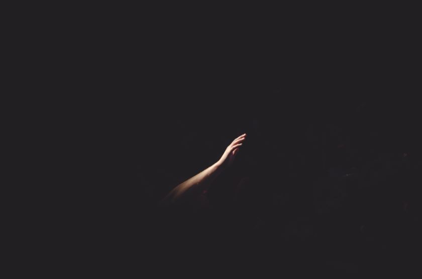 Hand reaching out in the darkness, Photo by Cherry Laithang on Unsplash